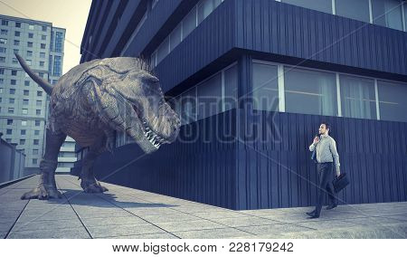Businessman Walking In Town And A Dinosaur Is Waiting For Him Round The Corner.
