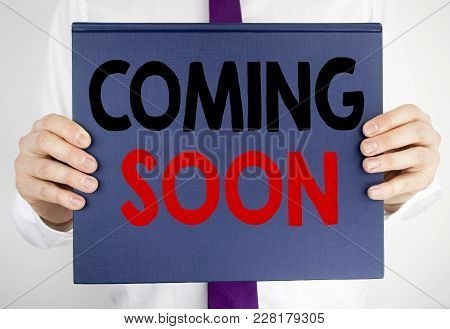 Writing Text Showing Coming Soon. Business Concept For Under Construction Written On Book Notebook P