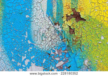 Surface Of The Old Wall With Cracked, Pelling Colored Paint And Spots. Abstract Background, Texture