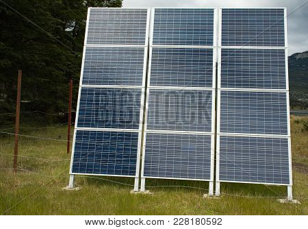 A Bank Of Twelve Solar Panels In The Wilderness Of Tierra Del Fuego National Park In Argentina.