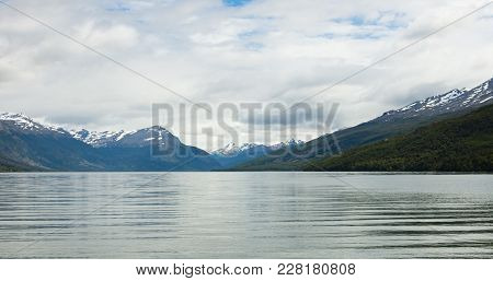 The Beagle Channel And Andes Mountains From Tierra Del Fuego National Park. Cumulus Clouds Are Overh