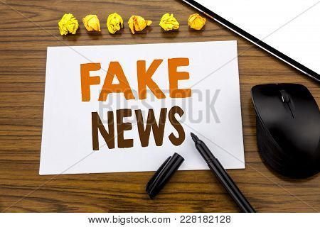 Conceptual Hand Writing Text Showing Fake News. Business Concept For Hoax Journalism Written On Stic