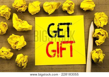 Get Gift. Business Concept For Free Shoping Coupon Written On Sticky Note Paper On Vintage Backgroun