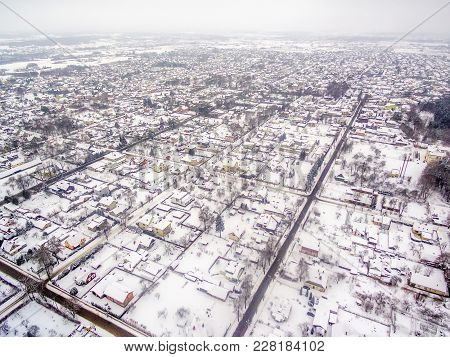 Aerial Top View Of Snowy Detached Houses In Winter