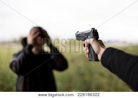 Give Me Chance. Shocked Frightened Man With His Hands Tied While A Killer Standing Near Him And Hold