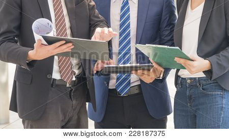 Hand And Work Document Of Business People Partners With The Smart Business Suite Of Men And Lady