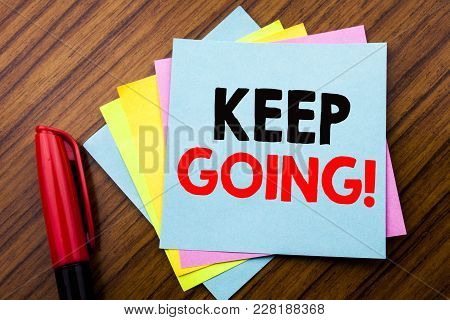 Handwriting Announcement Text Keep Going.  Concept For Go Moving Forward Letting Written On Sticky S