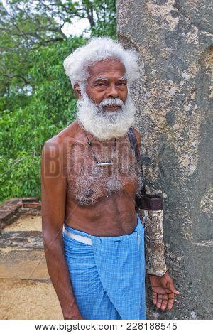 Polonnaruwa, Sri Lanka - May 10, 2003: An Elderly Sri Lankan Man In The Ancient City Of Polonnaruwa,