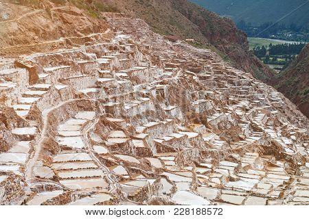 Natural Salt Mine In Peru. Brown Pools For Evaporation Water From Salt