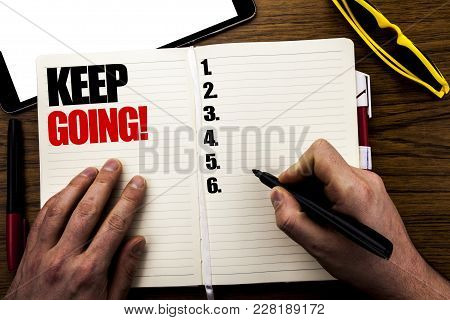Word, Writing Keep Going. Business Concept For Go Moving Forward Letting Written Book, Wooden Backgr