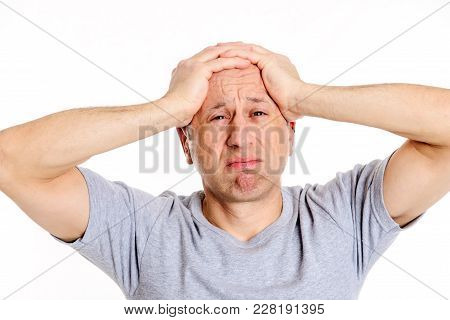 Man With Hands On Head Looking Shocked