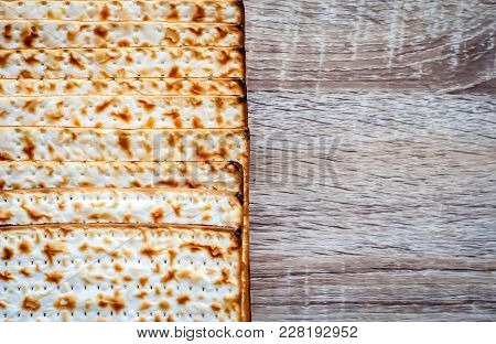 Traditional Jewish Matzah Unleavened Bread With A Vintage Background. Jewish Passover