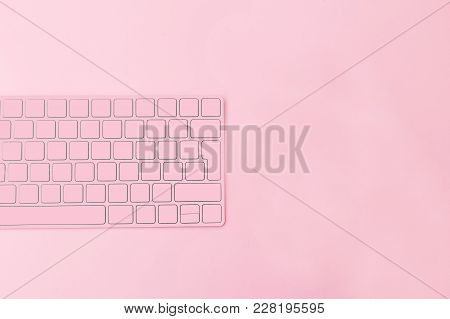 Cup Of Coffee And Keyboard On A Pink Background. Coffee Break