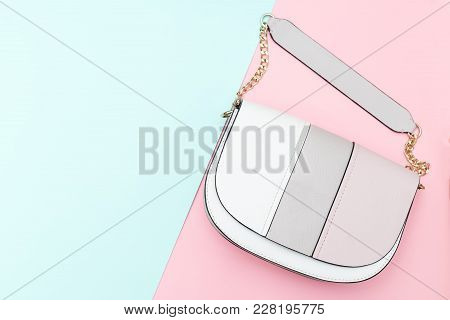 Women's Handbag On Two Pastel Color Background. Copy Space