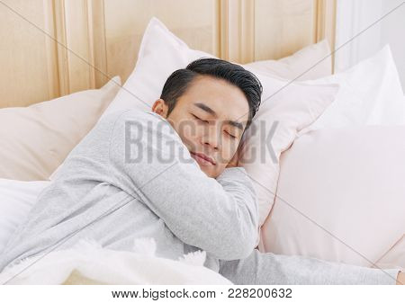 Young Man Sleeping In Bed, Concept Lifestyle