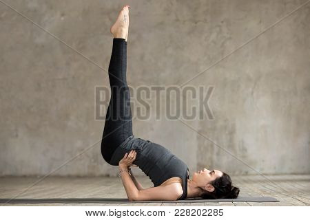 Young Sporty Woman Practicing Yoga, Doing Viparita Karani Exercise, Upside-down Pose, Working Out, W