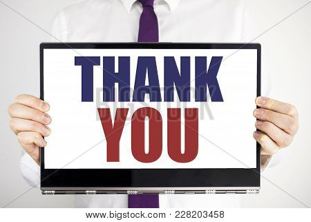 Word, Writing Thank You. Business Concept For Gratitude Thanks Written On Tablet Laptop Holding By M