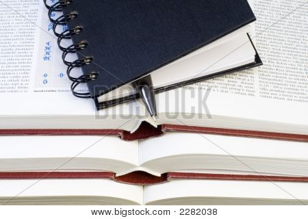 Notebook And Pen On Books