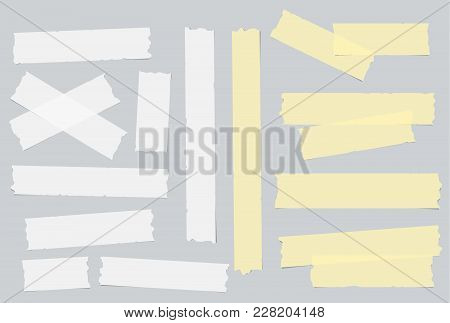 Yellow And White Different Size Adhesive, Sticky, Masking, Duct Tape, Paper Pieces On Gray Backgroun