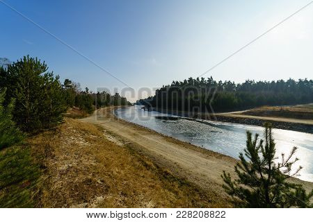 Winter View Of Sornoer Canal. Canal Connect Lakes Geierswalder See And Sedlitzer See. The Surroundin