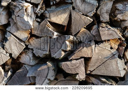 A Pile Of Dry Wood For Kindling A Fireplace.
