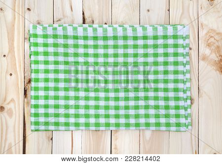 Green Checkered Tablecloth On Light Wooden Table, Top View, Copy Space