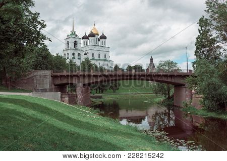 Horizontal Shot Of Ancient Fortress On The River Bank. Russia. Pskov Kremlin. Pskov Summer Time.