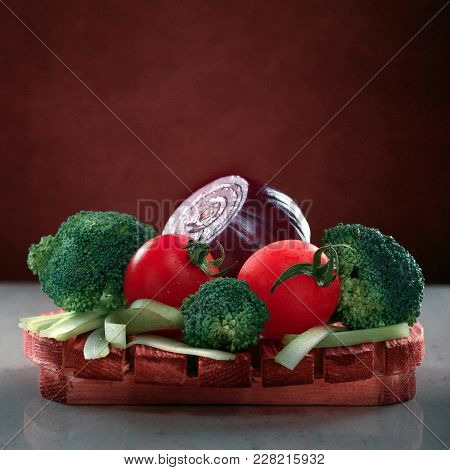Square Shot Of Concept Design Image For Cookbook Or Magazine Cover Vegetables On A Wooden Platter On
