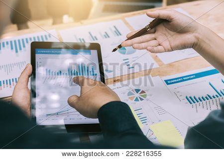 Business People Analysis With Graph On Digital Tablet At Room Office.