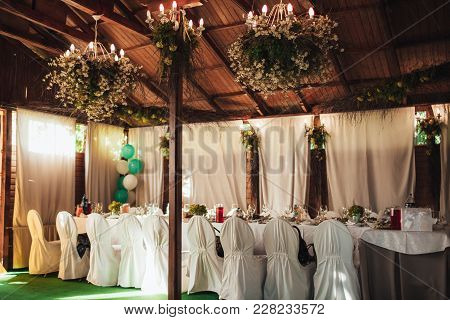 Wedding Banquet Table With Food And Drink At The Festival. The Rustic Styles.