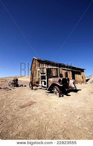 Old truck in front of an abandoned cabin