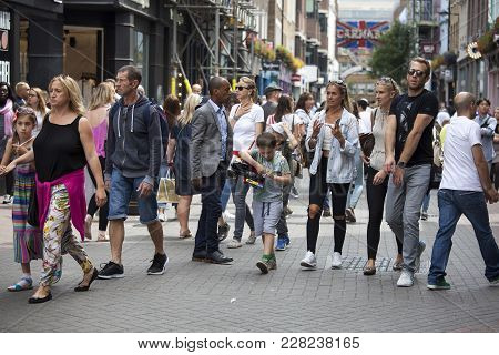 London, England - August 11 2017 A Multicolored Crowd Walks Along Carnaby Street. Carnaby Street Is