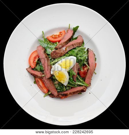 Roast beef appetizer in plate shot from above isolated on black background with clipping path