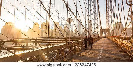 Couple Walking On Pedestrian Path Across Brooklyn Bridge. New York City Manhattan Downtown Skyline I
