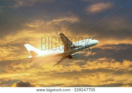 Airplane Closeup.airplane Flying In The Colorful Sunset Sky. White Flying Airplane. Airplane In The
