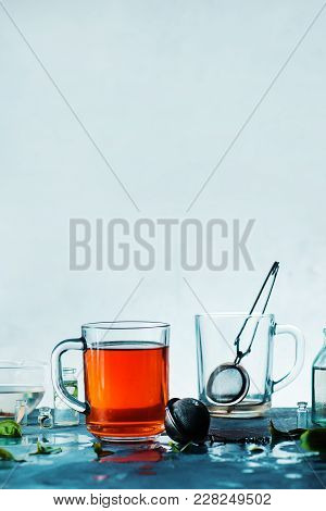Cup Of Tea And An Empty Cup With A Strainer On A Light Background With Copy Space. High-key Spring V