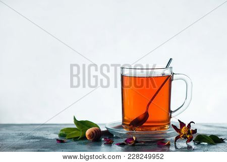 Herbal Tea In A Glass Cup With A Spoon On A Light Background With Copy Space. High-key Spring Still