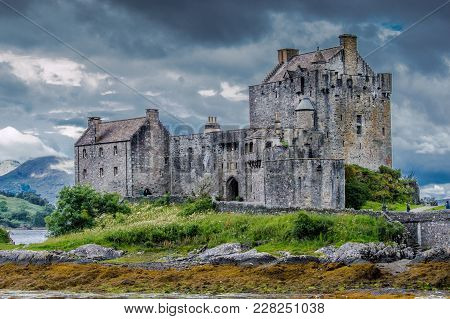 Eilean Donan Castle At Low Tide With A Dramatic Sky