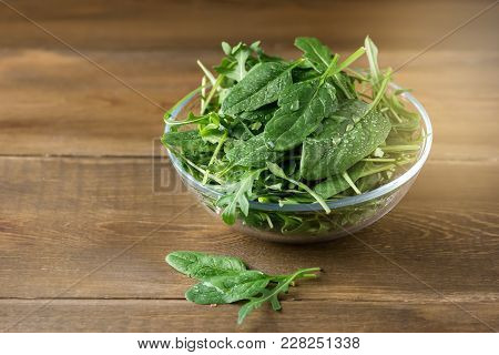 Bowl With Fresh Green Aragula And Spinach On Wooden Background Mix With Spinach Rucola Copy Space He