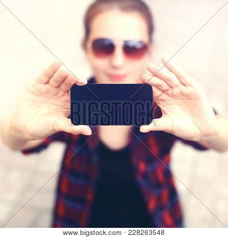 Blank Screen Phone, Woman Takes Pictures Self-portrait On The Frameless Smartphone