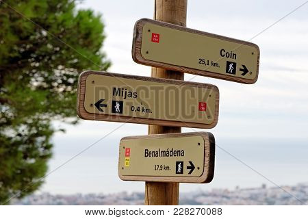 Wooden Hiking Trail Signpost With Multiple Directions In The Mijas Mountain, Near Mijas, Andalusia,