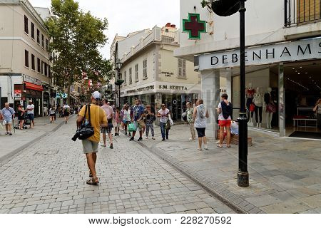 Gibraltar - August 29, 2017: Tourists Visit Main Street, The Main Arterial Street In The British Ove