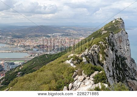 Gibraltar Rock View From Above, On The Left Gibraltar Town And Bay, La Linea Town In Spain At The Fa