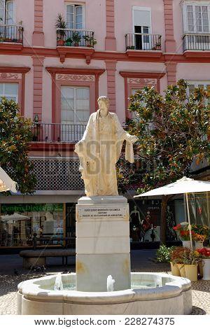 Cadiz, Spain - August 31, 2017: Statue Of Lucius Junius Moderatus Columella, Holding A Sickle And An