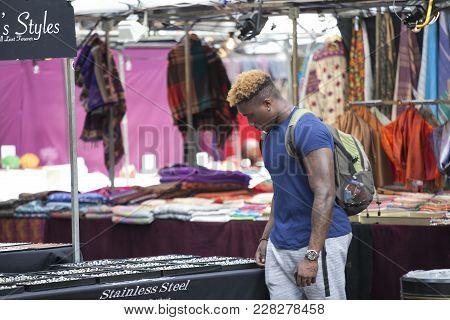 London, England - August 22, 2017 Buyers On The Spitalfelds Market Choose Clothes