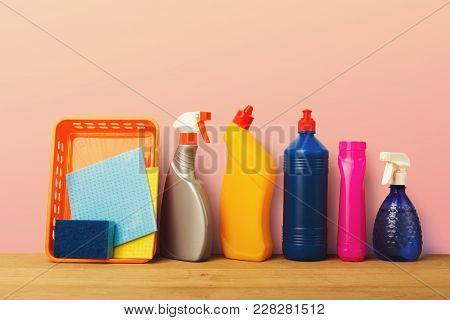 Group Of Colorful Bottles, Cleaning Products On Pink Background. House Keeping, Tidying Up, Spring-c