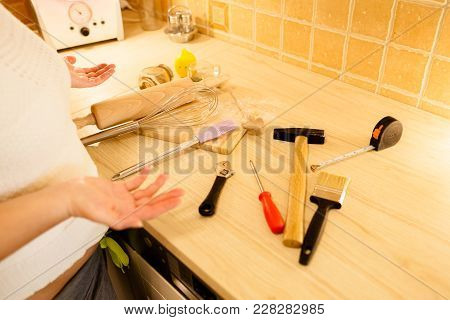 Woman Choice Kitchen Tools Or Man Tools. Gender Equality Concept.
