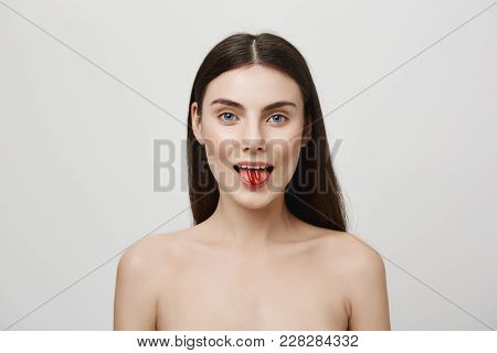 Body Needs Vitamins Every Day. Portrait Of Good-looking Young Caucasian Woman Sticking Out Tongue An