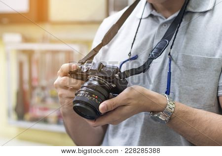Male Amateur Photographer Taking Focusing To Make Photos In Control Room,young Man Taking Pictures F