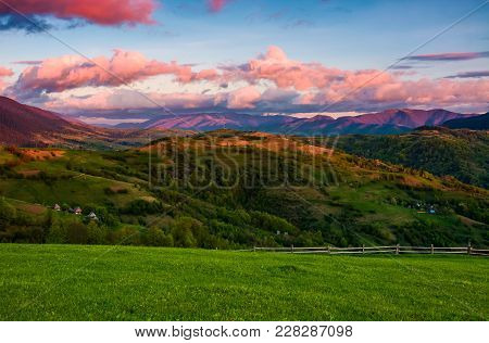 Beautiful Rural Area In Mountains. Gorgeous Landscape With Beautiful Cloud Formations Over The Mount